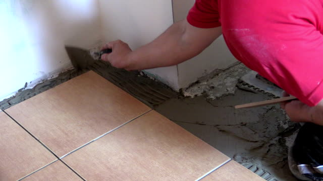 professional work at home interior floor tiling video