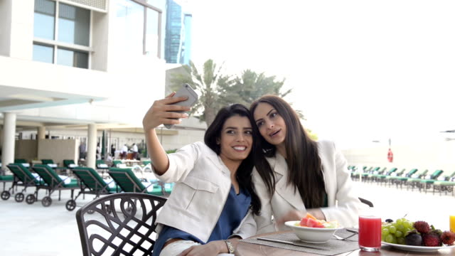 Professional young women taking a selfie video