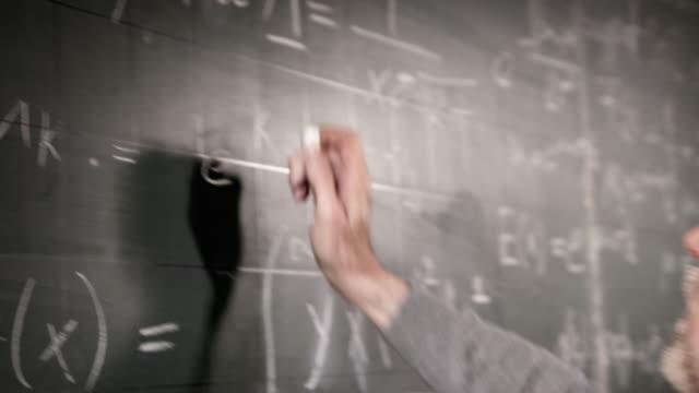 Professor writing on blackboard video