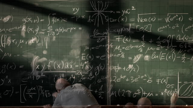 Professor writing on blackboard (timelapse) video