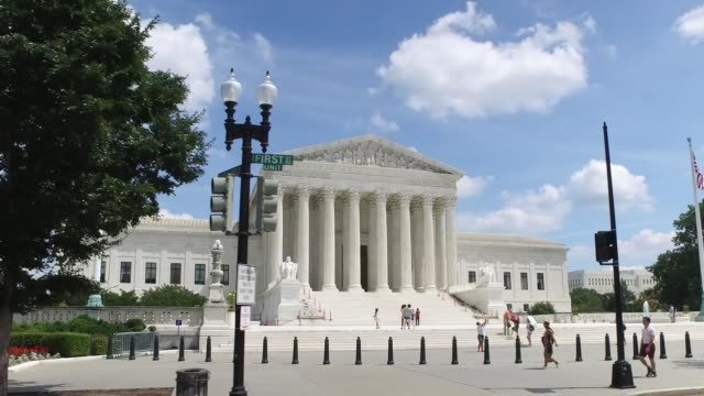 profile driving perspective outside supreme court - dolly shot video stock e b–roll