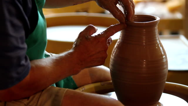 Profile of a man at the potter's wheel video