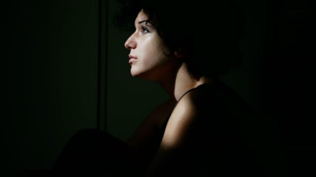 profile of sad ,pensive brunette in twilight - scuro video stock e b–roll