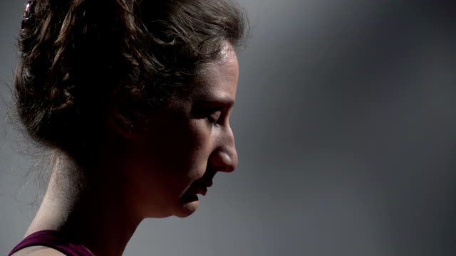Profile of woman breathing during yoga video