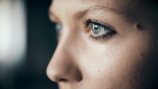 Profile of young woman with blue eyes Close up of woman's blue eyes. power stock videos & royalty-free footage
