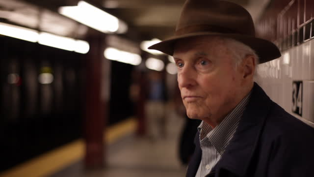 stockvideo's en b-roll-footage met med profile old man on subway platform looking out   watching     waiting for train - alleen één man