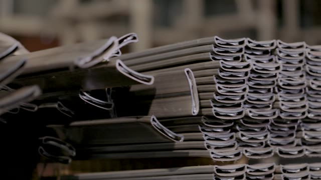 Profile pipe in a covered warehouse, profile pipe laid in rows in a large warehouse, warehouse with metal Square profile pipe, metal warehouse. Clean, metal warehouse, metal profile stacked in rows. Close-up, panorama durability stock videos & royalty-free footage