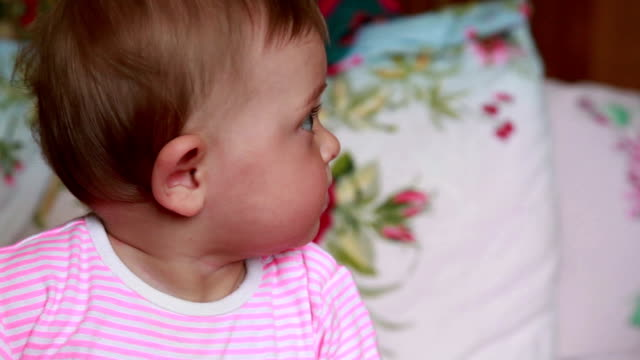 Profile view of a curious baby video