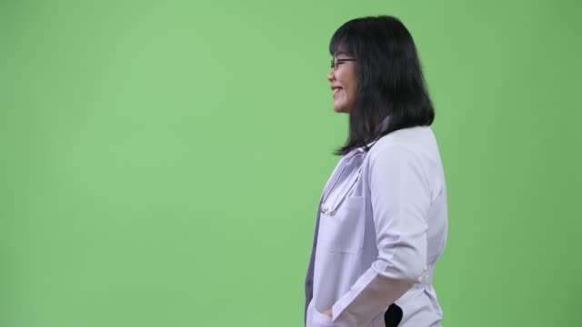 profile view of beautiful happy asian woman doctor - юго восток стоковые видео и кадры b-roll