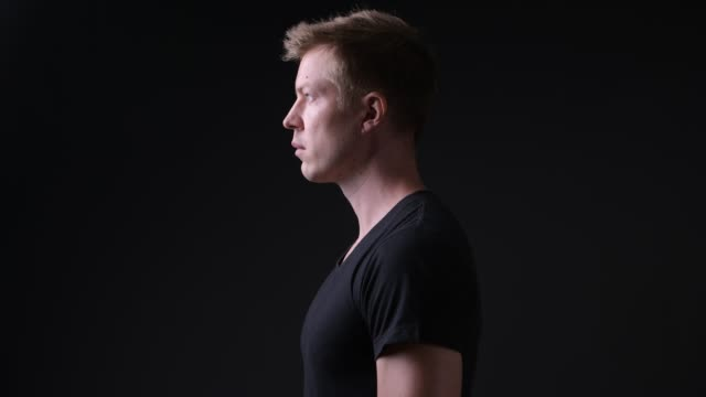 Profile View Of Man Against Black Background