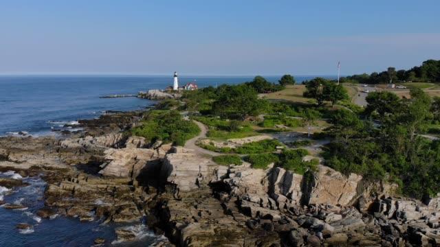 Profile View of Rocky Coastline and Portland Head Lighthouse video
