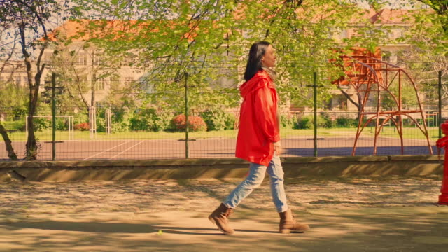 profile woman walks in city