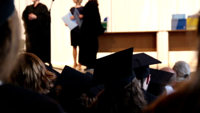 MBA program graduates receiving diplomas on stage, shaking hand MBA program graduates receiving diplomas on stage, shaking hand to professor diploma stock videos & royalty-free footage