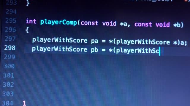 Programming code entering down on computer screen terminal