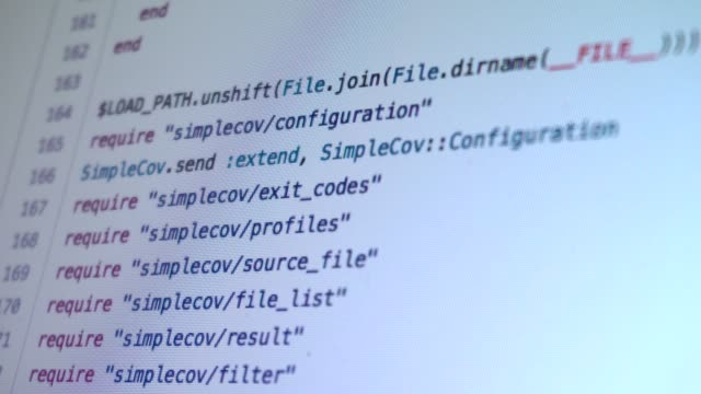 programming code running down at computer screen terminal - spyware filmów i materiałów b-roll