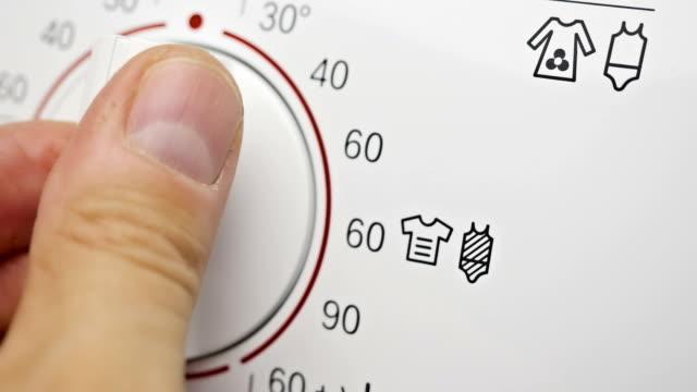 Programming washing machine. Choosing the temperature. Programming washing machine by choosing the temperature. electronics store stock videos & royalty-free footage