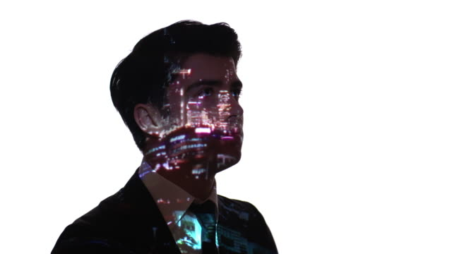 Projection of city lights on a businessman's face video