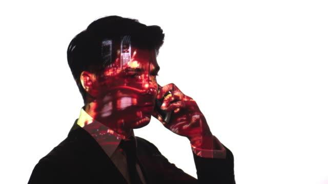 stockvideo's en b-roll-footage met projectie van de poort op een zakenman gezicht timelapse - dubbelopname businessman