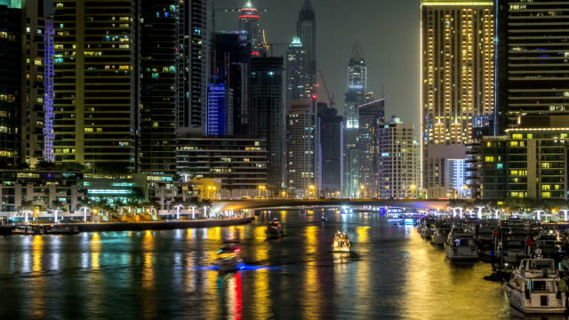 Promenade and canal in Dubai Marina timelapse at night, UAE video