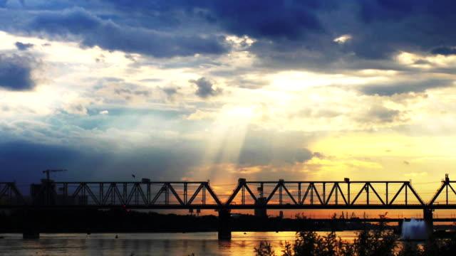 Promenade on beautiful sunset background at the sea and bridge. 3840x2160 video