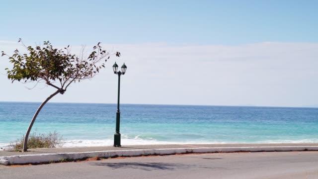 promenade walking area on seaside in greek resort - пелопоннес стоковые видео и кадры b-roll