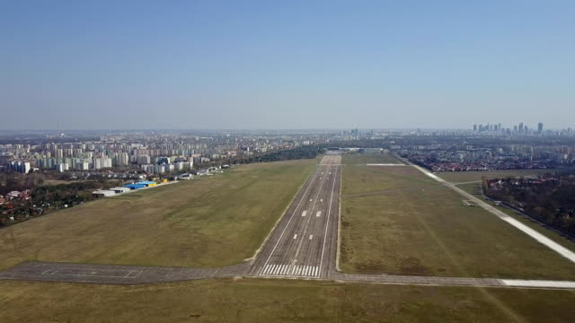 Propeller airplane taking off from airport runway on a sunny day, aerial shot. FullHD video Propeller airplane taking off from airport runway on a sunny day. FullHD clip airfield stock videos & royalty-free footage