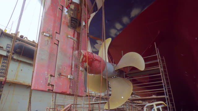 Propeller of ship during drydock renovation Vessel during repair in port industry and transport propeller stock videos & royalty-free footage