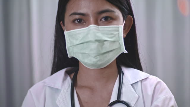 Protect And Care uncomfortable ,Female Doctor occupational safety and health stock videos & royalty-free footage