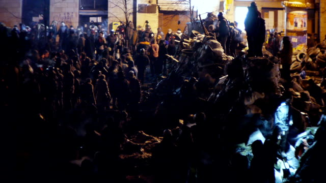 Protesters build barricades at night during riot video