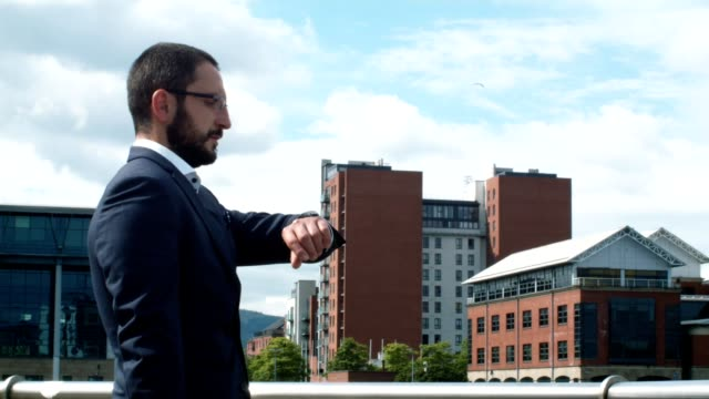 Proud And Succesfull Businessman Looking At His Watch. video