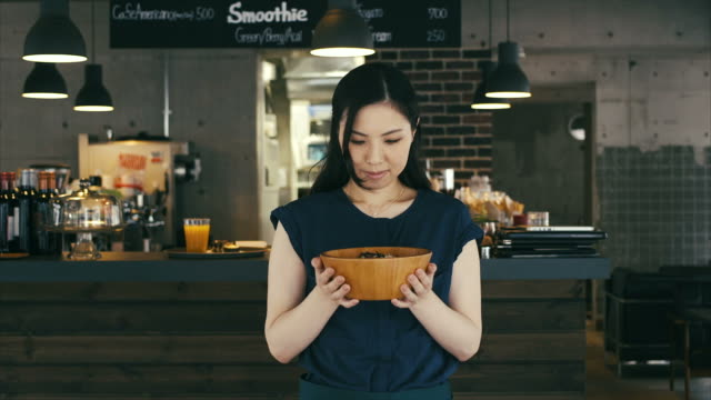 Proud Asian Girl Showing a Bowl with Fresh Food video