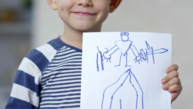 Proud Boy Showing His Drawing video