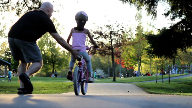 Proud Dad Helps Daughter Ride Her New Bike video