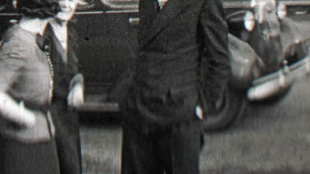 1938: Proud family poses front yard of classic 30's car. video