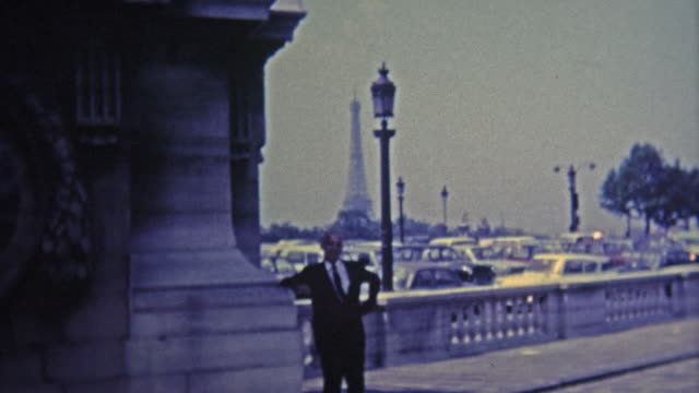 PARIS, FRANCE - 1969: Proud frenchman poses by his Eiffel Tower.