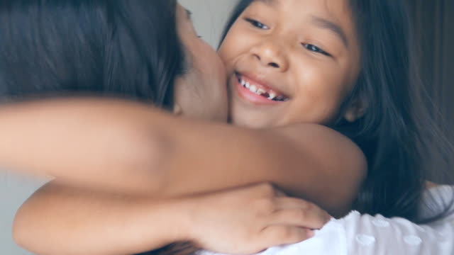 Proud mother hugging daughter, Slow motion Video slow motion of Proud mother hugging daughter. hug stock videos & royalty-free footage