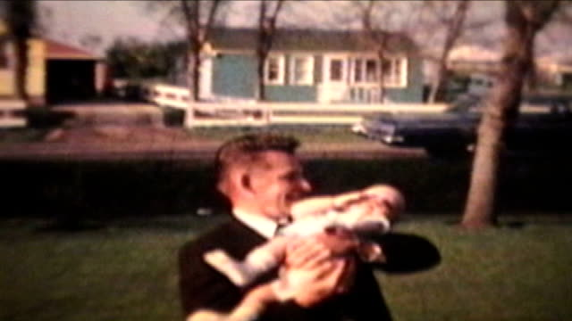 Proud Parents Holding Baby Outdoors (1963 - Vintage 8mm)