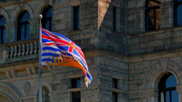 4K Provincial Flag of British Columbia in Front of Legislature Buildings video