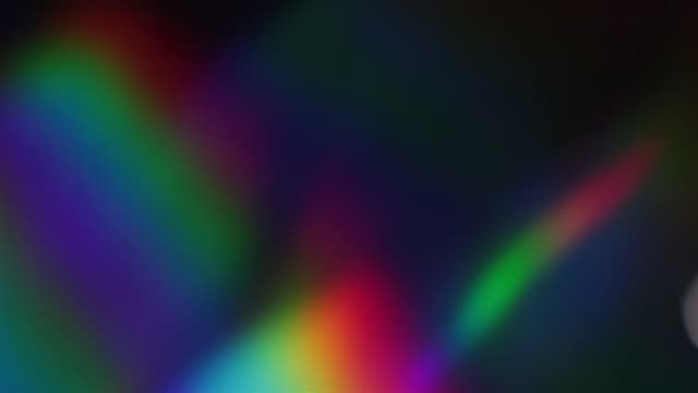 psychedelic holographic rainbow foil. rgb multicolored shiny surface and shining abstract background. - призма стоковые видео и кадры b-roll