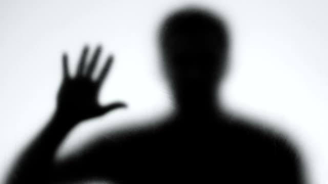 Psychopath shadow behind glass wall, mental disorder, horror mystery, nightmare
