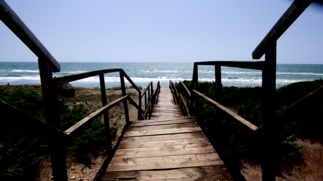 Public beach wooden bridge access.