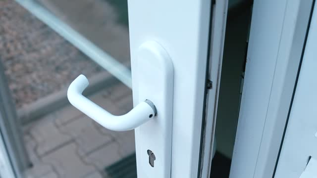 Public building door handle as surface of transmission of viruses and infections Public building door handle as a surface of transmission of viruses and infections. Opening and closing doors. handle stock videos & royalty-free footage