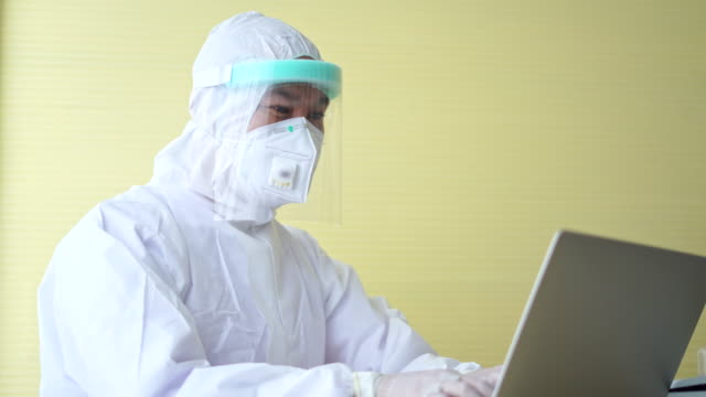 Public health officials working on laptop during the coronavirus