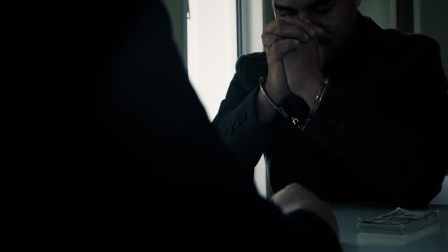 public official handcuffed. - wine filmów i materiałów b-roll