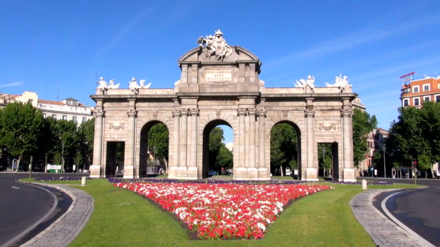 Puerta de Alcala front landmark public neo-classical monument Puerta de Alcala or Gate, arch door, in Madrid city, Spain, Europe, from year 1778 neoclassical architecture stock videos & royalty-free footage