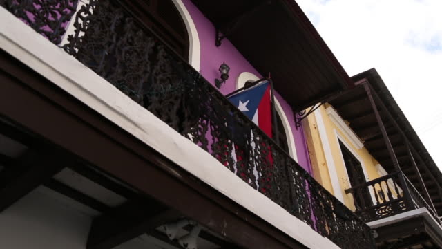 Puerto Rico Flag Hanging On Purple Balcony Puerto Rico Flag Hanging On Purple Balcony puerto rico stock videos & royalty-free footage