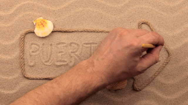 puerto rico inscription written by hand on the sand, in the pointer made from rope. - portorico video stock e b–roll