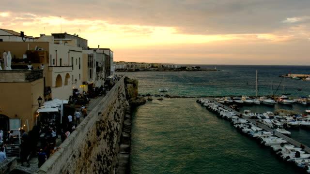puglia - salento - otranto sunset at harbour in the old south italy village - lecce video stock e b–roll