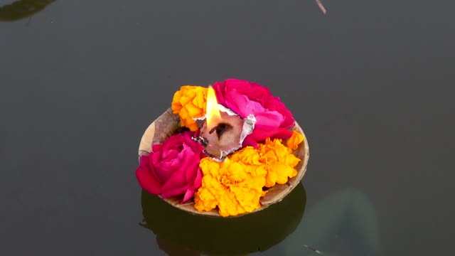 puja flowers and candle  on sacred indian river Ganges video