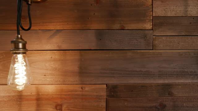 Pull Back as Vintage Modern Wood Wall Light Turns On